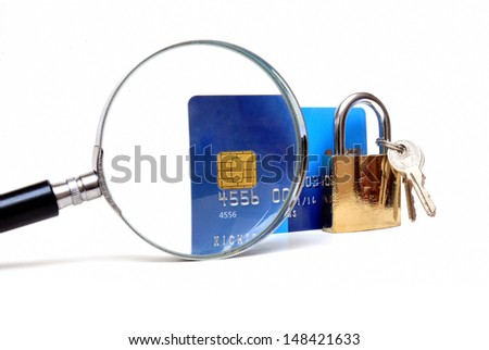 Secure banking and online shopping, credit card and padlock with magnifying glass - stock photo