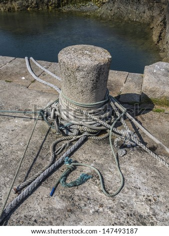secured ropes from a large boat - stock photo