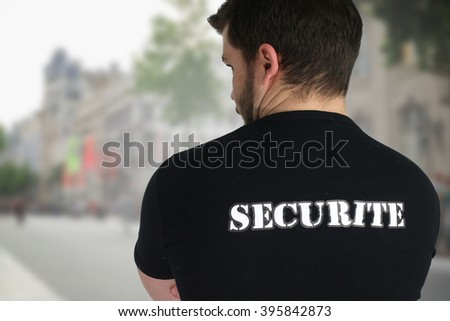 Security agent posing back in a street - stock photo
