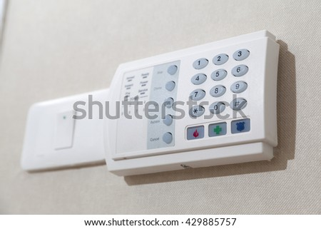 Security alarm keypad of a home - stock photo