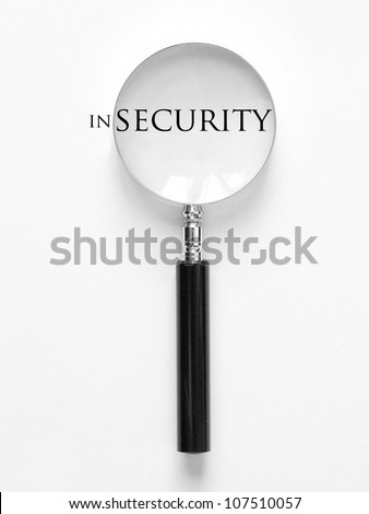 Security and magnifying glass - stock photo