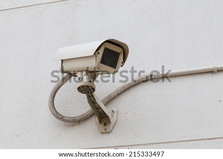 Security Camera and Urban Video CCTV for Monitoring People - stock photo