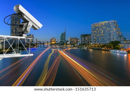Security camera detects the movement of traffic  along Chao Phraya River sunset twilight - stock photo