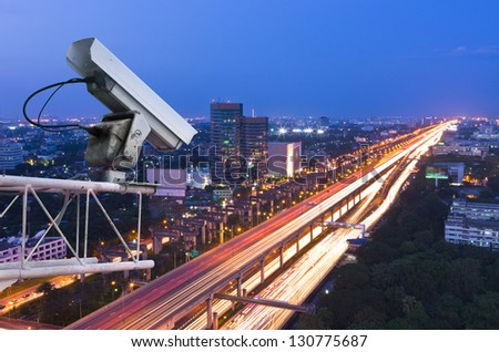 Security camera detects the movement of traffic. Skyscraper rooftop. - stock photo