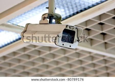 Security camera in the public place of buildings - stock photo