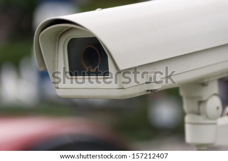 Security camera inspection. - stock photo