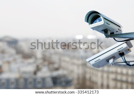 security camera on a city - stock photo