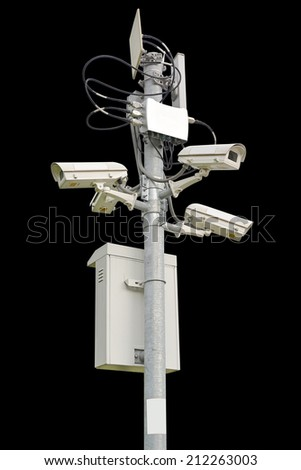 Security camera on black background - stock photo