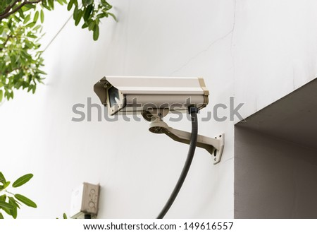 Security Camera or CCTV on the wall - stock photo