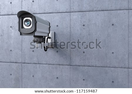 security camera watching to the left on concrete wall - stock photo