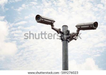 Security cameras against blue sky / Security cameras  - stock photo