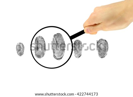 Security Concept. Examination of fingerprints under a magnifying glass - stock photo