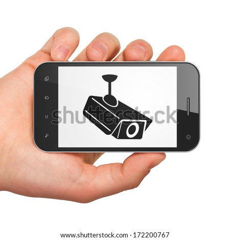 Security concept: hand holding smartphone with Cctv Camera on display. Mobile smart phone on White background, 3d render - stock photo