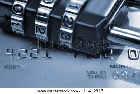 Security concept in transaction (toned in blue). Card expired a few years ago. - stock photo