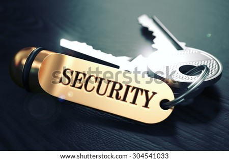 Security Concept. Keys with Golden Keyring on Black Wooden Table. Closeup View, Selective Focus, 3D Render. Toned Image. - stock photo
