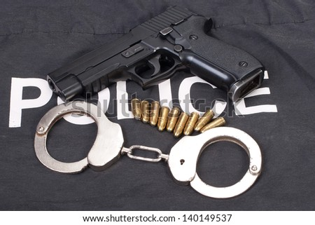 security concept with gun ammo and handcuffs - stock photo