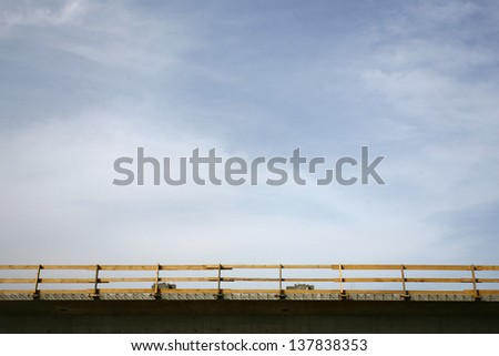 security fence in the road, wooden fence - stock photo