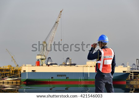 security Guard jetty and background Logistics . - stock photo
