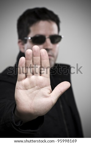 Security guard says Stop - stock photo