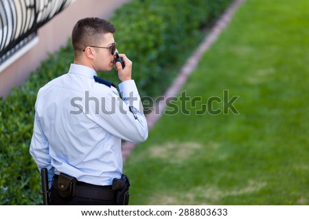 Security guard working outdoor. - stock photo