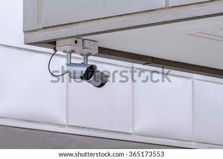 Security IR camera for monitor events in city. - stock photo