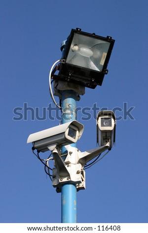 Security light & camera. - stock photo