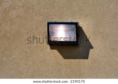 Security light mounted on a concrete wall - stock photo