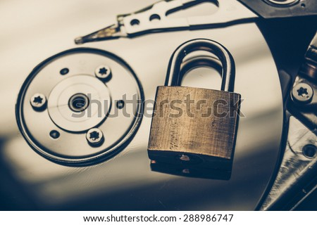 security lock on a computer hard disk - stock photo