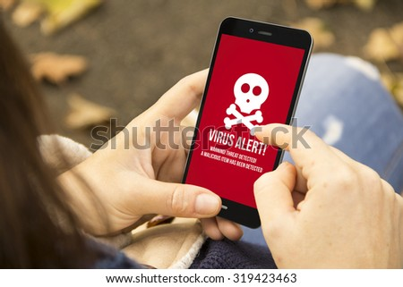 security mobile concept: woman holding a 3d generated smartphone with virus alert on the screen. Graphics on screen are made up. - stock photo