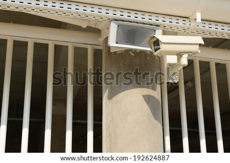 Security system on the fence - stock photo