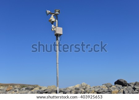 Security system post on a rocky coast at New Zealand - stock photo