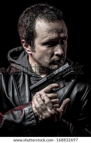Security, thief, armed man with black leather jacket, dangerous - stock photo