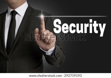 Security touchscreen is operated by businessman. - stock photo