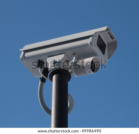 security video camera and blue sky - stock photo