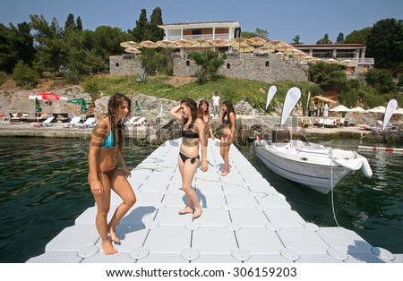 SEDEF ISLAND, TURKEY - AUGUST 4: Young people sunbathing and having fun in Sedef Island on August 4, 2010 in Istanbul, Turkey. Island is officially a neighborhood in the Adalar district of Istanbul. - stock photo