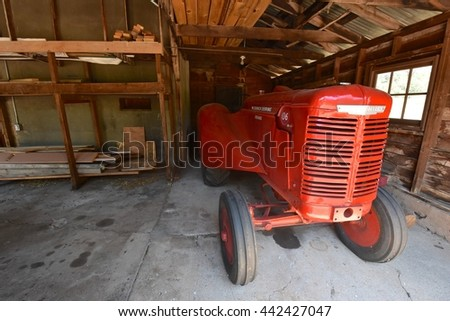 SEDONA, AZ - JUNE 20:  Red Tractor for Apple Harvest at Slide Rock State Park in Sedona, AZ on June 20.2016. One of the most beautiful parks in Arizona, and many people visit every year. - stock photo