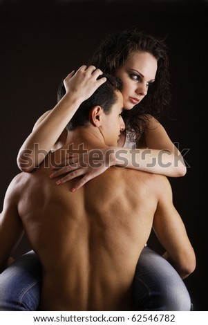 Seducing each other while isolated on black background - stock photo