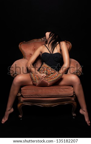Seductive girl on a throne of pleasure - stock photo