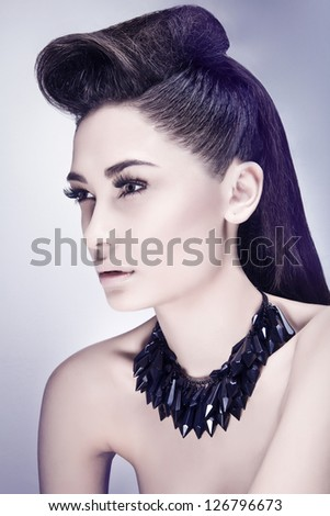Seductive girl super model with necklace posing in studio over white background - stock photo