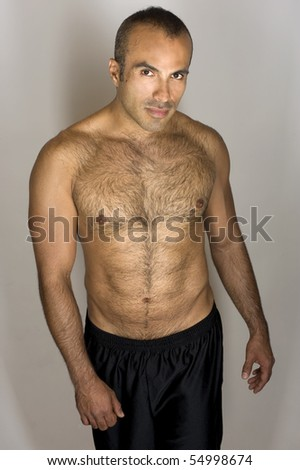Seductive Hispanic Man - stock photo
