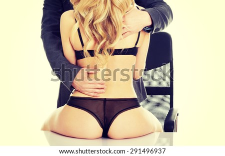 Seductive woman and man - office romance concept. - stock photo