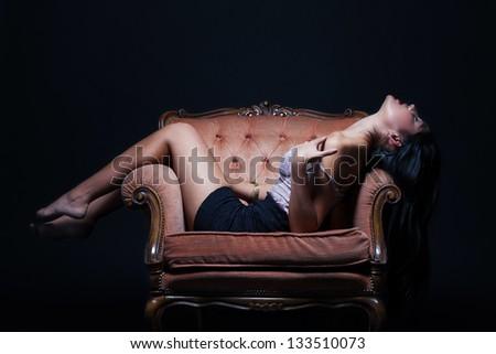 Seductive woman on a throne of pleasure - stock photo
