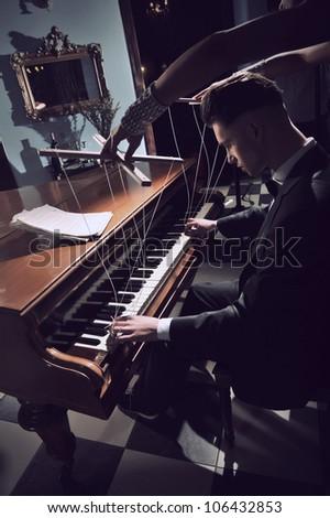 Seductive woman on the piano - stock photo
