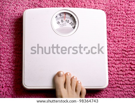 See my other feet on surfaces images. Foot placed onto bathroom scales - stock photo