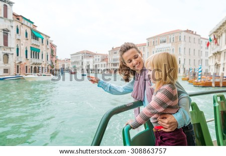 See those buildings over there, and how the water goes right up the steps? The buildings haven't changed in hundreds of years. Venice is a very historical place! - stock photo