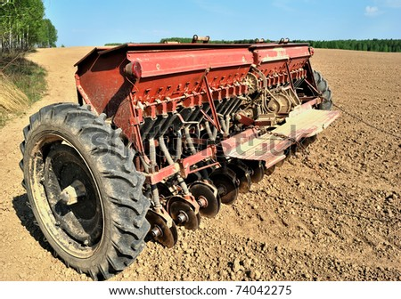Seeder. Agricultural machinery. Planting of spring. - stock photo