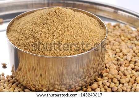 seeds and powder of coriander spice - stock photo