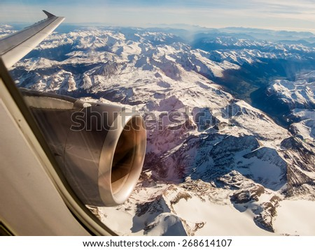 seen the alps in austria from an airplane in a flight from - stock photo