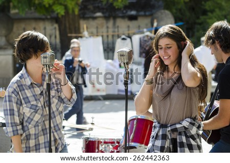 SEGOVIA, SPAIN - SEPTEMBER 20, 2014: A young band, calling themselves Zarigueyas, playing in the main square free for anyone who wants to listen. - stock photo
