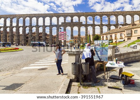 SEGOVIA, SPAIN - SEPTEMBER 6: An aqueduct in Segovia the longest ancient Roman aqueduct which has remained in Western Europe on September 6, 2015 - stock photo